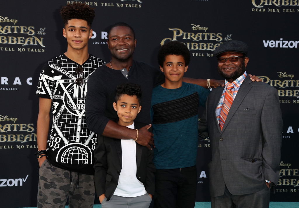 ". HOLLYWOOD, CA - MAY 18:  Actor David Oyelowo (2nd Left) with family attend the premiere of Disney\'s ""Pirates Of The Caribbean: Dead Men Tell No Tales\"" at Dolby Theatre on May 18, 2017 in Hollywood, California.  (Photo by Frederick M. Brown/Getty Images)"