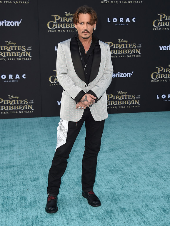 ". Johnny Depp arrives at the Los Angeles premiere of ""Pirates of the Caribbean: Dead Men Tell No Tales\"" at the Dolby Theatre on Thursday, May 18, 2017. (Photo by Jordan Strauss/Invision/AP)"