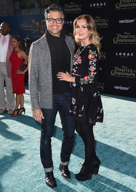". Jaime Camil, left, and Heidi Balvanera arrive at the Los Angeles premiere of ""Pirates of the Caribbean: Dead Men Tell No Tales\"" at the Dolby Theatre on Thursday, May 18, 2017. (Photo by Jordan Strauss/Invision/AP)"