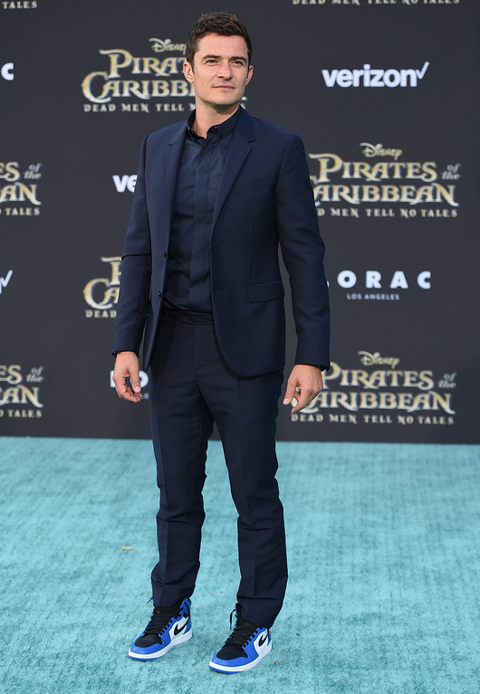 ". Orlando Bloom arrives at the Los Angeles premiere of ""Pirates of the Caribbean: Dead Men Tell No Tales\"" at the Dolby Theatre on Thursday, May 18, 2017. (Photo by Jordan Strauss/Invision/AP)"