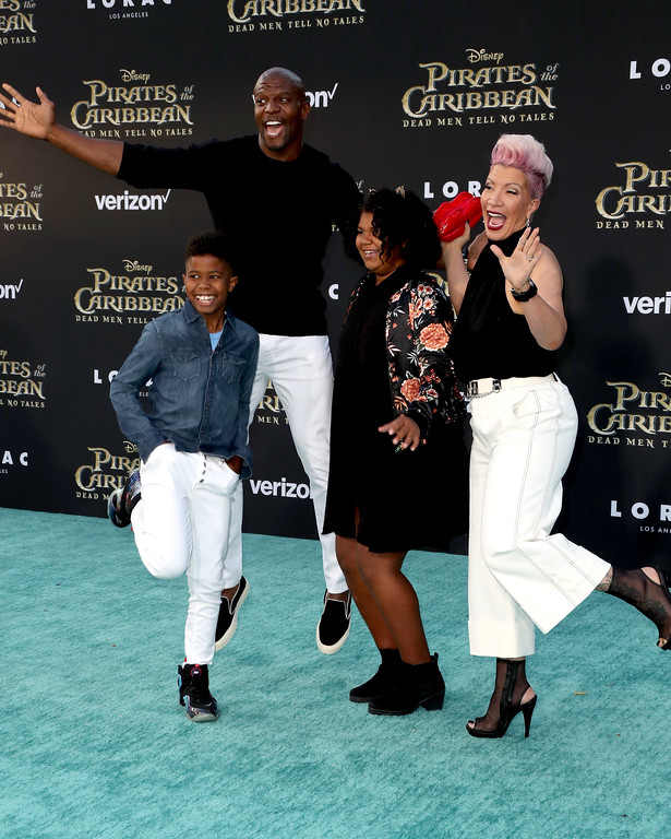 ". HOLLYWOOD, CA - MAY 18:  Actor Terry Crews (2nd Left) with Rebecca Crews (R) and children attend the premiere of Disney\'s ""Pirates Of The Caribbean: Dead Men Tell No Tales\"" at Dolby Theatre on May 18, 2017 in Hollywood, California.  (Photo by Frederick M. Brown/Getty Images)"