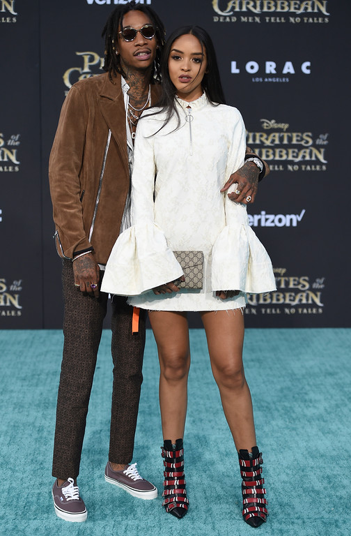 ". Wiz Khalifa, left, and Izabela Guedes arrive at the Los Angeles premiere of ""Pirates of the Caribbean: Dead Men Tell No Tales\"" at the Dolby Theatre on Thursday, May 18, 2017. (Photo by Jordan Strauss/Invision/AP)"