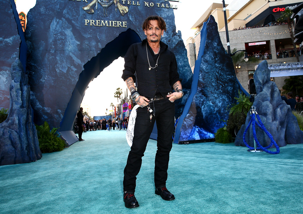 ". HOLLYWOOD, CA - MAY 18:  Actor Johnny Depp attends the premiere of Disney\'s ""Pirates Of The Caribbean: Dead Men Tell No Tales\"" at Dolby Theatre on May 18, 2017 in Hollywood, California.  (Photo by Rich Fury/Getty Images)"