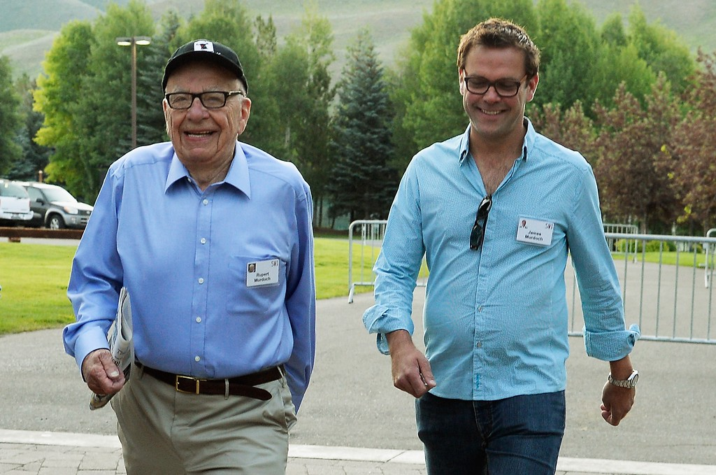 . Media mogul Rupert Murdoch (C) executive chairman of News Corporation and chairman and CEO of 21st Century Fox; James Murdoch, (R) son of  Rupert Murdoch and the deputy chief operating officer of News Corporation; arrive for morning session of the Allen & Co. annual conference at the Sun Valley Resort on July 10, 2013 in Sun Valley, Idaho.   (Photo by Kevork Djansezian/Getty Images)