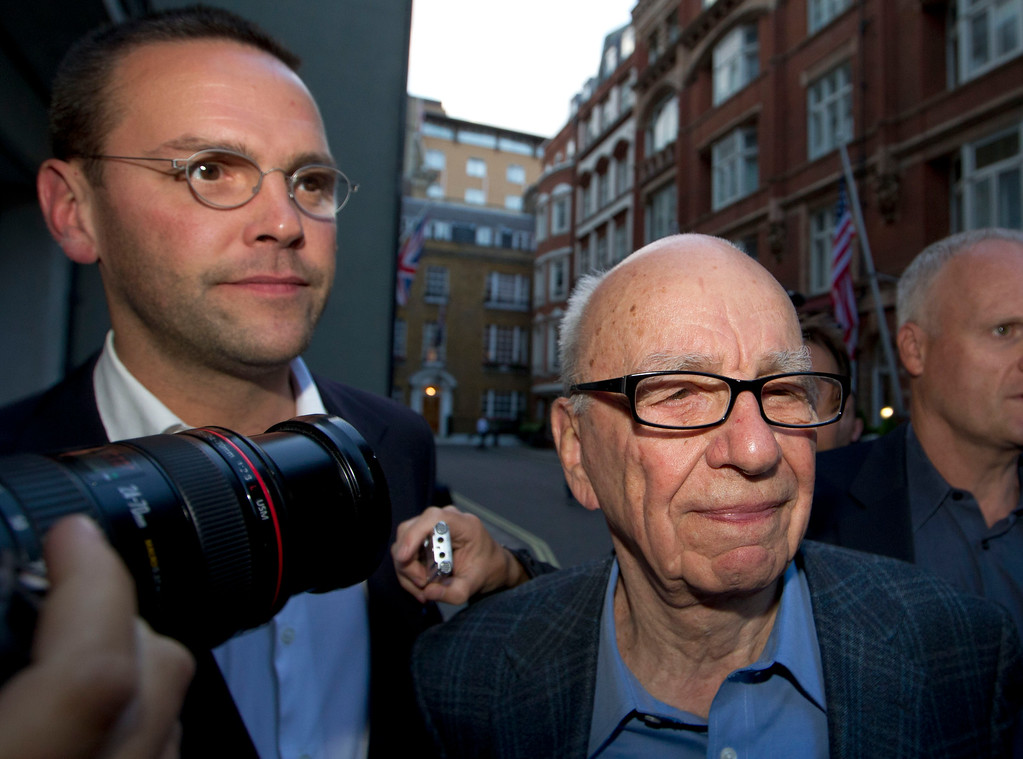 . FILE - This Sunday July 10, 2011 file photo shows Chairman of News Corporation Rupert Murdoch, right, and his son James Murdoch, chief executive of News Corporation Europe and Asia arrive at his residence in central London.  (AP Photo/Sang Tan, file)