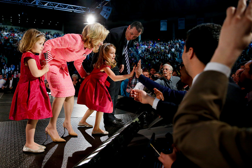 . Sen. Ted Cruz, R-Texas and his wife Heidi watch as their daughter Caroline, 6, center, high-fives members of the crowd after Cruz announced his campaign for president, Monday, March 23, 2015, at Liberty University, founded by the late Rev. Jerry Falwell, in Lynchburg, Va. Cruz, who announced his candidacy on twitter in the early morning hours, is the first major candidate in the 2016 race for president. Also pictured is Catherine Cruz, 4, left. (AP Photo/Andrew Harnik)