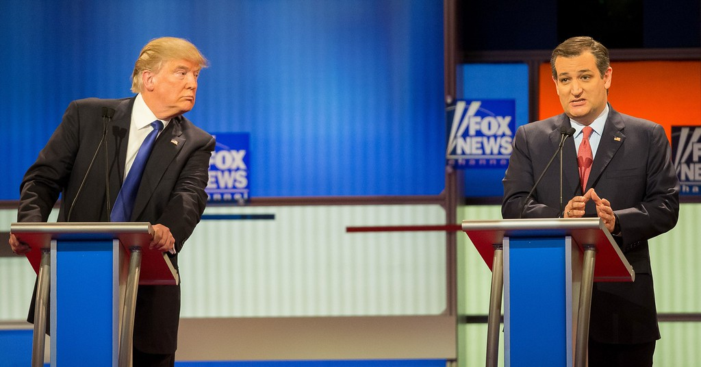 """. File - Republican Presidential candidate Ted Cruz (R) responds to a question as Donald Trump listens during the Republican Presidential Debate in Detroit, Michigan, March 3, 2016. Cruz announced Friday, Sept. 23, 2016, he will vote for Donald Trump, a dramatic about-face for the Texas senator who previously called the New York businessman a \""""pathological liar\"""" and \""""utterly amoral.\"""" (GEOFF ROBINS/AFP/Getty Images)"""