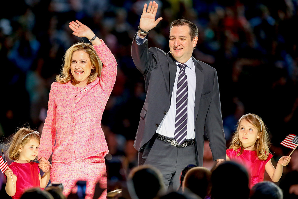 . Sen. Ted Cruz, R-Texas, his wife Heidi, and their two daughters Catherine, 4, left, and Caroline, 6, right, wave on stage after he announced his campaign for president, Monday, March 23, 2015, at Liberty University, founded by the late Rev. Jerry Falwell, in Lynchburg, Va. Cruz, who announced his candidacy on twitter in the early morning hours, is the first major candidate in the 2016 race for president. (AP Photo/Andrew Harnik)