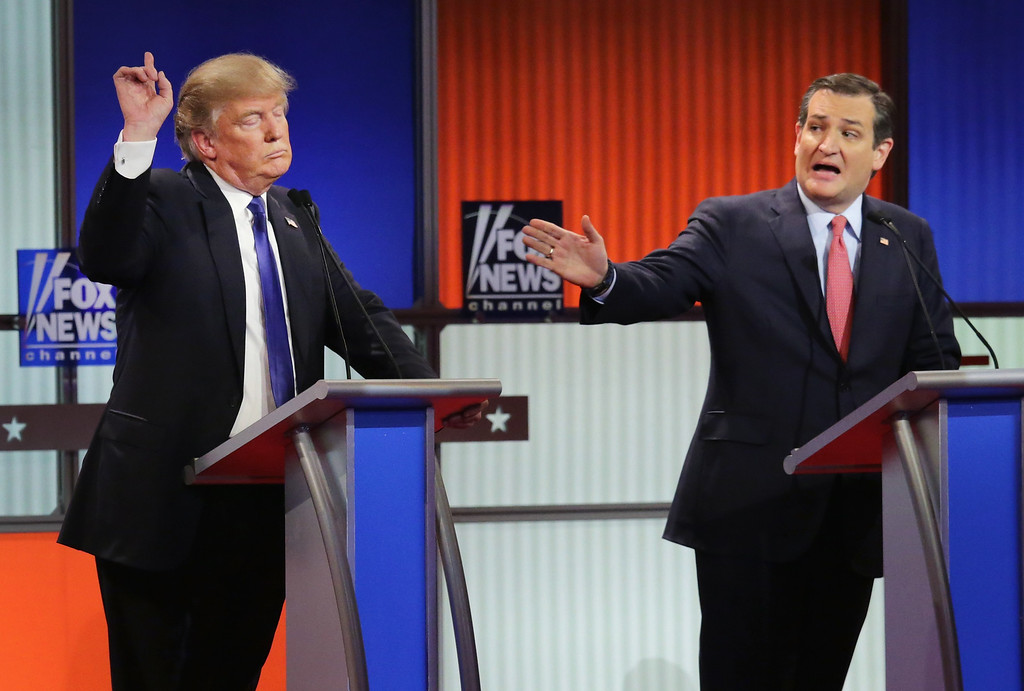 """. Republican presidential candidates (Lto R) Donald Trump and Sen. Ted Cruz (R-TX) participate in a debate sponsored by Fox News at the Fox Theatre on March 3, 2016 in Detroit, Michigan. Cruz announced Friday, Sept. 23, 2016, he will vote for Donald Trump, a dramatic about-face for the Texas senator who previously called the New York businessman a \""""pathological liar\"""" and \""""utterly amoral.\""""  (Photo by Chip Somodevilla/Getty Images)"""