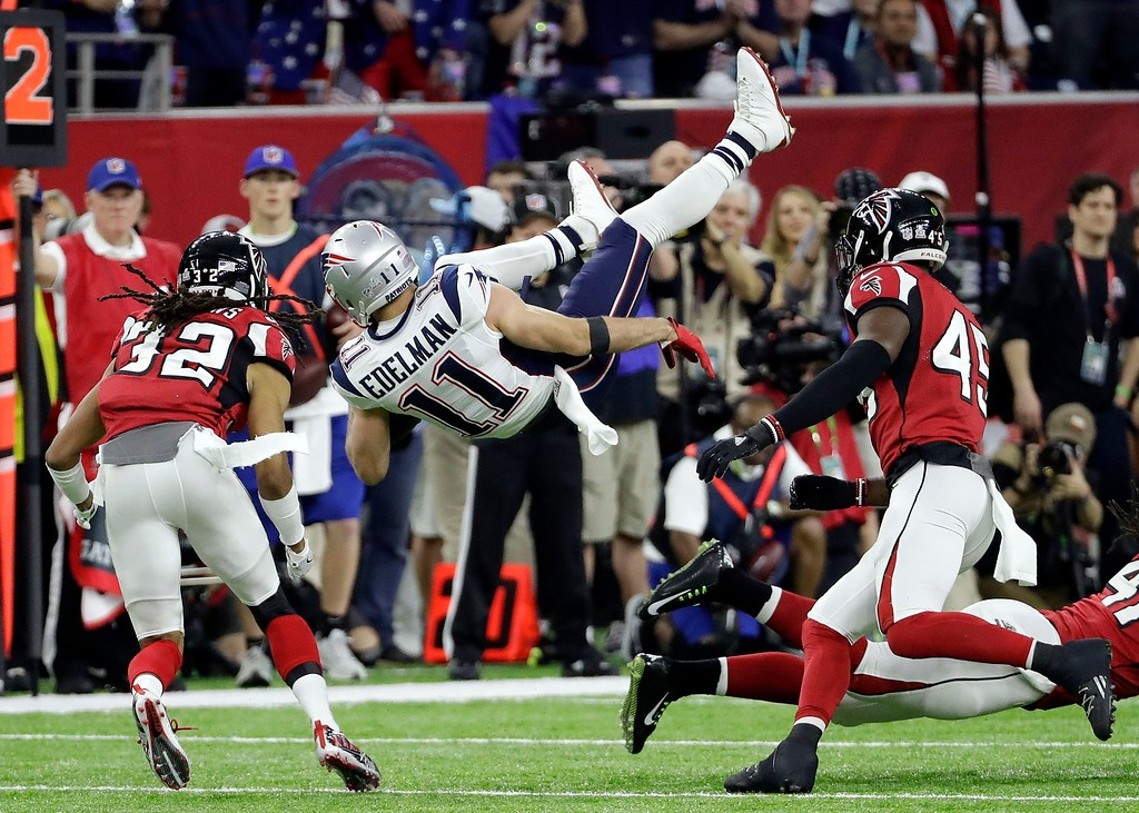 . New England Patriots\' Julian Edelman (11) is upended by Atlanta Falcons\' Philip Wheeler during the first half of the NFL Super Bowl 51 football game Sunday, Feb. 5, 2017, in Houston. (AP Photo/David J. Phillip)