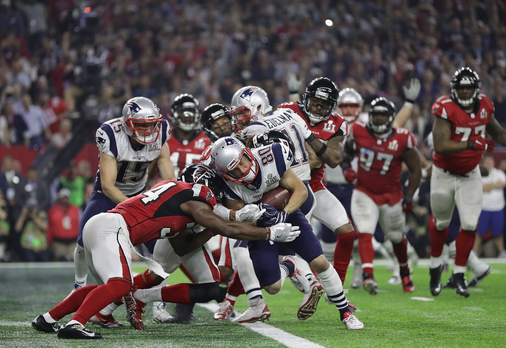 . HOUSTON, TX - FEBRUARY 05:  Danny Amendola #80 of the New England Patriots scores a two point conversion late in the fourth quarter against Jalen Collins #32 and Brian Poole #34 of the Atlanta Falcons during Super Bowl 51 at NRG Stadium on February 5, 2017 in Houston, Texas.  (Photo by Ronald Martinez/Getty Images)