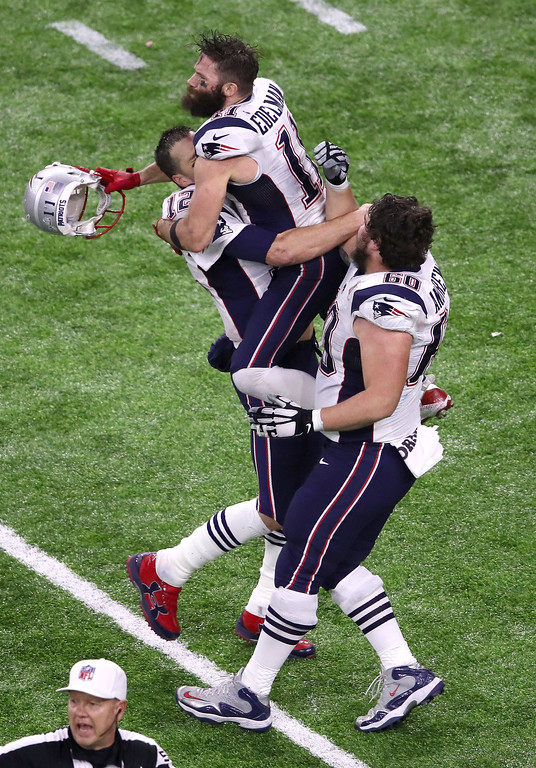 . HOUSTON, TX - FEBRUARY 05: Tom Brady #12, Julian Edelman #11 and David Andrews #60 of the New England Patriots celebrate after defeating the Atlanta Falcons during Super Bowl 51 at NRG Stadium on February 5, 2017 in Houston, Texas. The Patriots defeated the Falcons 34-28. (Photo by Ezra Shaw/Getty Images)