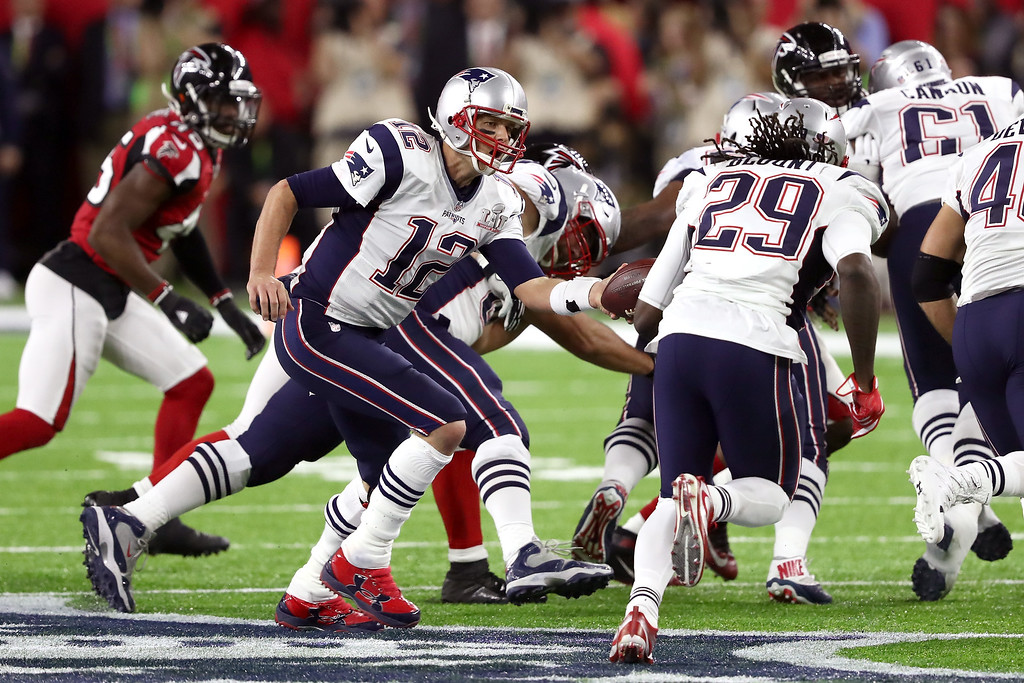 . HOUSTON, TX - FEBRUARY 05: Tom Brady #12 of the New England Patriots hands the ball off to LeGarrette Blount #29 during the second quarter of Super Bowl 51 against the Atlanta Falcons  at NRG Stadium on February 5, 2017 in Houston, Texas.  (Photo by Elsa/Getty Images)