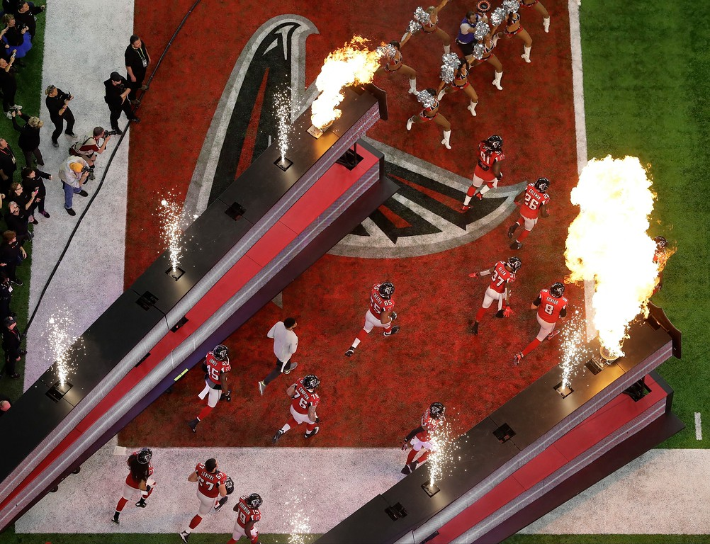 . Atlanta Falcons players take the field before the NFL Super Bowl 51 football game against the New England Patriots Sunday, Feb. 5, 2017, in Houston. (AP Photo/Tim Donnelly)