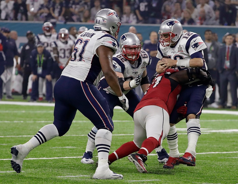 . Atlanta Falcons\' Grady Jarrett sacks New England Patriots\' Tom Brady during the second half of the NFL Super Bowl 51 football game Sunday, Feb. 5, 2017, in Houston. (AP Photo/David J. Phillip)