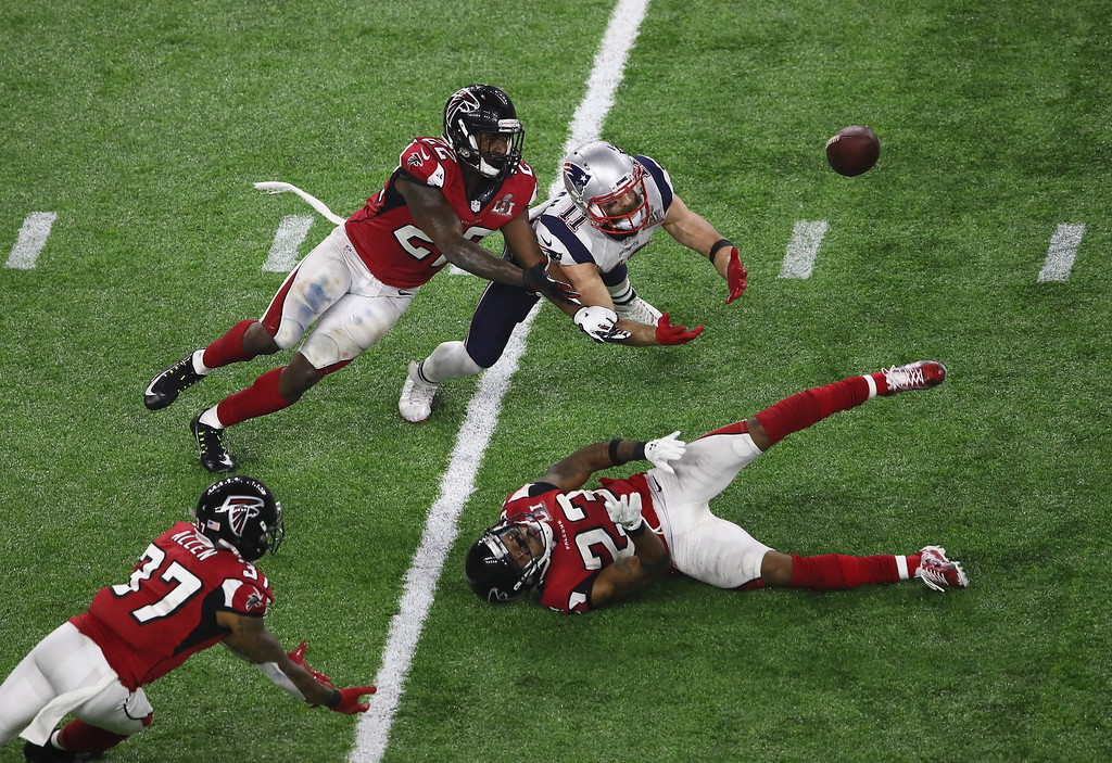 . HOUSTON, TX - FEBRUARY 05:  Julian Edelman #11 of the New England Patriots makes a 23 yard catch in the fourth quarter against Ricardo Allen #37, Robert Alford #23 and Keanu Neal #22 of the Atlanta Falcons during Super Bowl 51 at NRG Stadium on February 5, 2017 in Houston, Texas.  (Photo by Ezra Shaw/Getty Images)