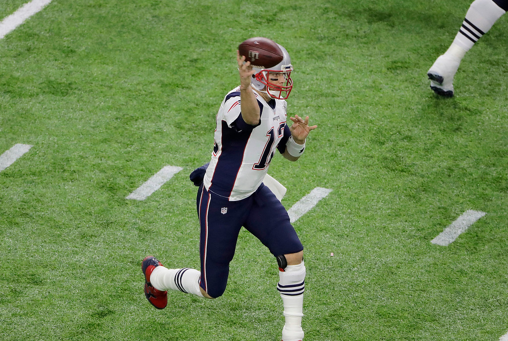 . New England Patriots\' Tom Brady passes against the Atlanta Falcons during the first half of the NFL Super Bowl 51 football game Sunday, Feb. 5, 2017, in Houston. (AP Photo/Charlie Riedel)