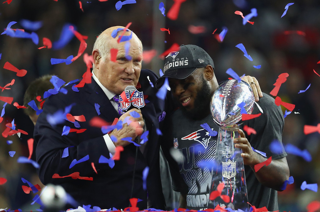 . HOUSTON, TX - FEBRUARY 05: James White #28 of the New England Patriots celebrates with the Vince Lombardi trophy after defeating the Atlanta Falcons during Super Bowl 51 at NRG Stadium on February 5, 2017 in Houston, Texas. The Patriots defeated the Falcons 34-28. (Photo by Al Bello/Getty Images)