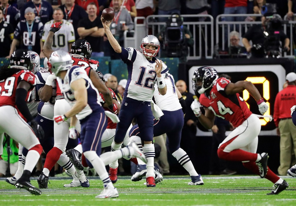 . New England Patriots\' Tom Brady passes against the Atlanta Falcons during the first half of the NFL Super Bowl 51 football game Sunday, Feb. 5, 2017, in Houston. (AP Photo/Elise Amendola)