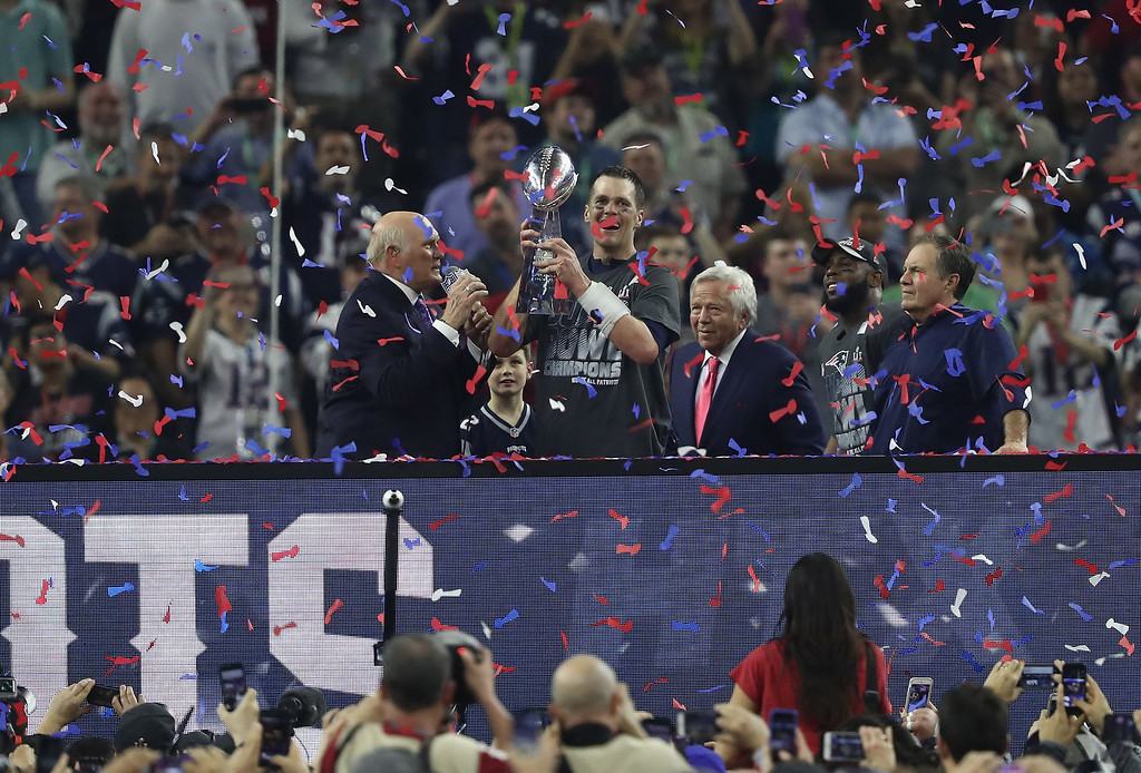 . HOUSTON, TX - FEBRUARY 05:  Tom Brady #12 of the New England Patriots celebreates with the Vince Lombardi Trophy after defeating the Atlanta Falcons during Super Bowl 51 at NRG Stadium on February 5, 2017 in Houston, Texas. The Patriots defeated the Falcons 34-28.  (Photo by Elsa/Getty Images)