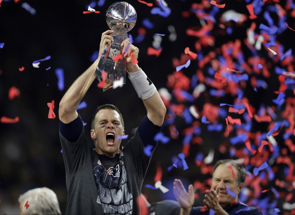 . New England Patriots\' Tom Brady raises the Vince Lombardi Trophy after defeating the Atlanta Falcons in overtime at the NFL Super Bowl 51 football game Sunday, Feb. 5, 2017, in Houston. The Patriots defeated the Falcons 34-28. (AP Photo/Darron Cummings)