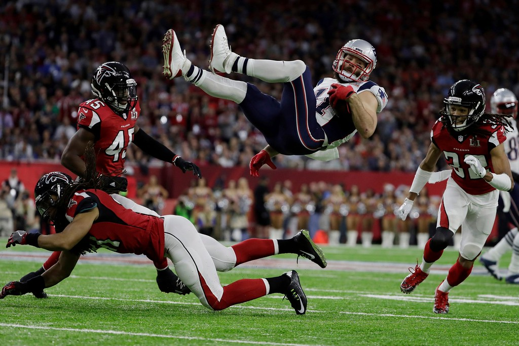 . New England Patriots\' Julian Edelman is up ended by Atlanta Falcons\' Philip Wheeler, during the first half of the NFL Super Bowl 51 football game Sunday, Feb. 5, 2017, in Houston. (AP Photo/Matt Slocum)