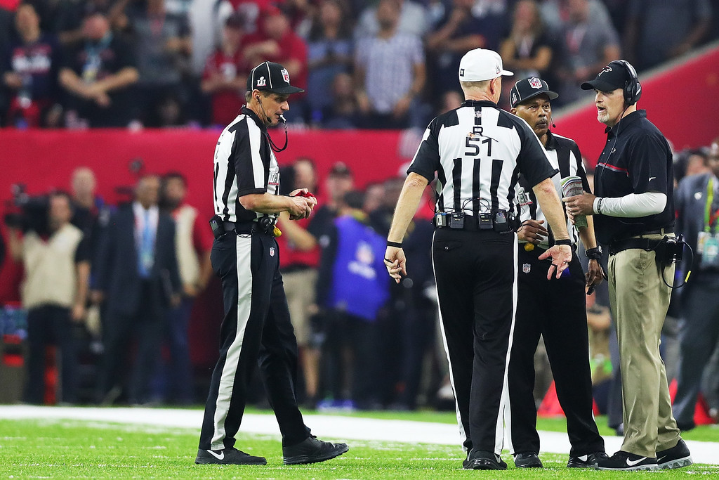 . HOUSTON, TX - FEBRUARY 05:  Head coach Dan Quinn of the Atlanta Falcons talks with the officials during a time out against the New England Patriots during Super Bowl 51 at NRG Stadium on February 5, 2017 in Houston, Texas.  (Photo by Tom Pennington/Getty Images)