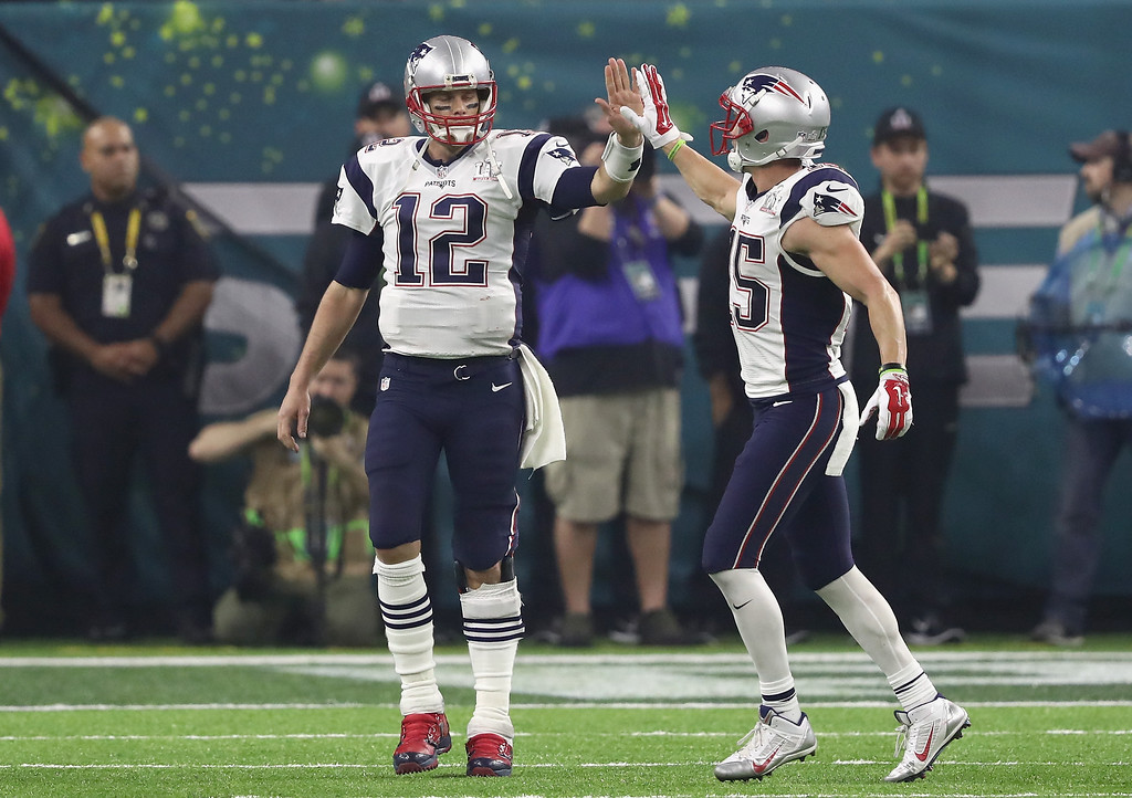 . HOUSTON, TX - FEBRUARY 05: Tom Brady #12 and Chris Hogan #15 of the New England Patriots celebrate after a touchdown and two-point conversion in the fourth quarter against the Atlanta Falcons during Super Bowl 51 at NRG Stadium on February 5, 2017 in Houston, Texas.  (Photo by Elsa/Getty Images)