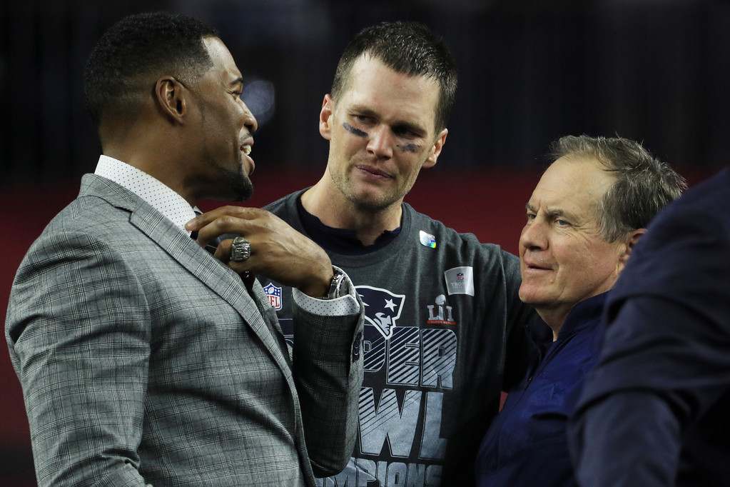 . HOUSTON, TX - FEBRUARY 05:  Michael Strahan, Tom Brady #12 and head coach Bill Belichick of the New England Patriots reacts after defeating the Atlanta Falcons 34-28 in overtime during Super Bowl 51 at NRG Stadium on February 5, 2017 in Houston, Texas.  (Photo by Mike Ehrmann/Getty Images)