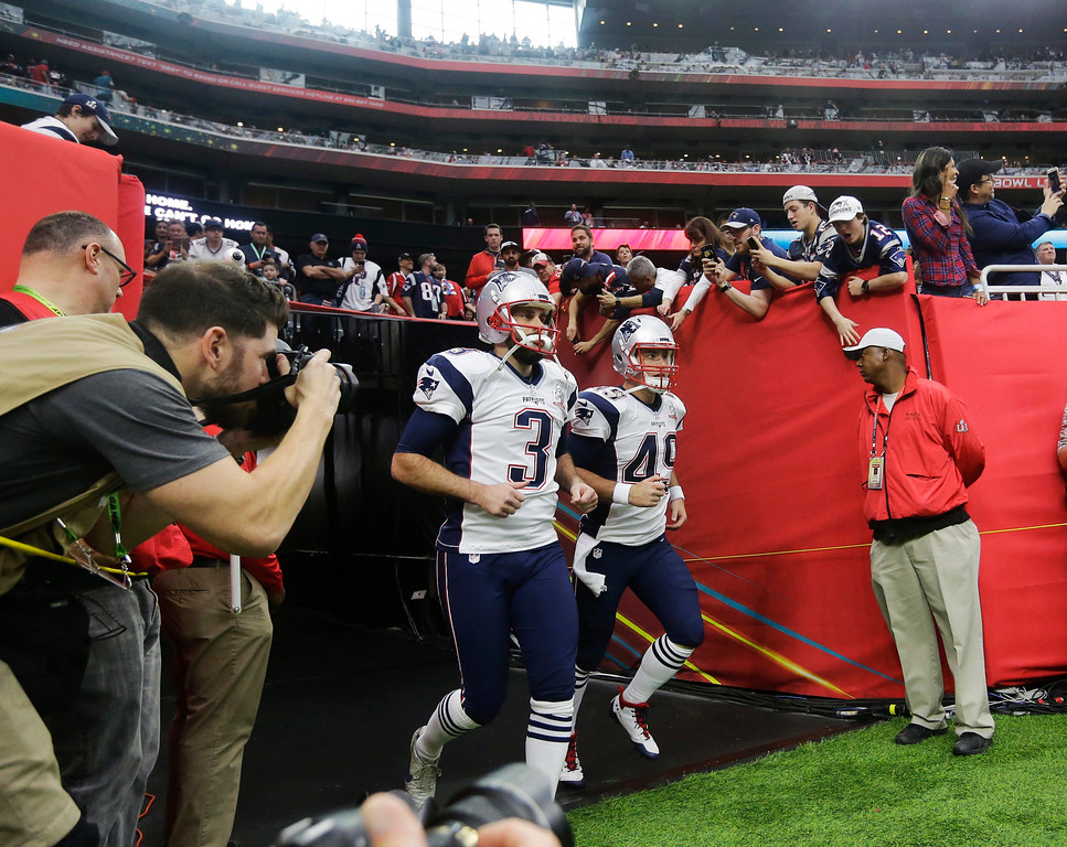 . New England Patriots\' Stephen Gostkowski, left, and Joe Cardona run on to the field before the NFL Super Bowl 51 football game against the Atlanta Falcons, Sunday, Feb. 5, 2017, in Houston. (AP Photo/Elise Amendola)