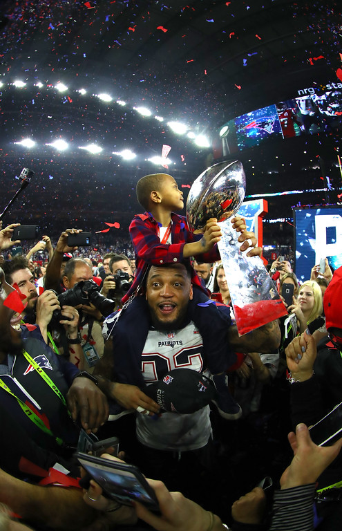 . HOUSTON, TX - FEBRUARY 05: Justin Coleman #22 of the New England Patriots celebrates with the Vince Lombardi trophy after the Patriots defeat the Atlanta Falcons 34-28 in Super Bowl 51 at NRG Stadium on February 5, 2017 in Houston, Texas.  (Photo by Al Bello/Getty Images)