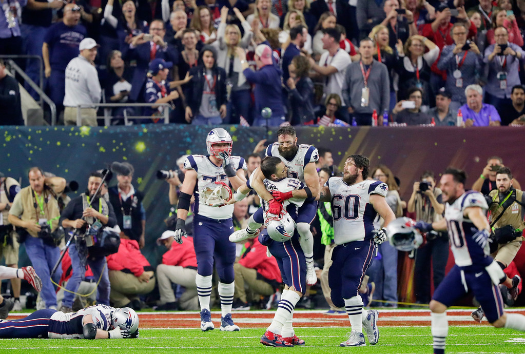 . HOUSTON, TX - FEBRUARY 05:  Tom Brady #12 of the New England Patriots celebrates with Julian Edelman #11 after defeating the Atlanta Falcons 34-28 in overtime to win Super Bowl 51 at NRG Stadium on February 5, 2017 in Houston, Texas.  (Photo by Jamie Squire/Getty Images)