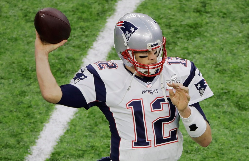 . New England Patriots\' Tom Brady warms up before the NFL Super Bowl 51 football game against the Atlanta Falcons, Sunday, Feb. 5, 2017, in Houston. (AP Photo/Charlie Riedel)