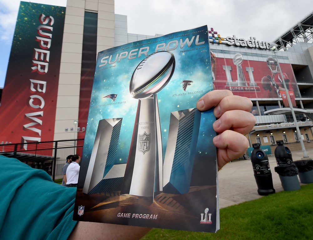 . A person holds up the game program for Super Bowl LI between the New England Patriots and the Atlanta Falcons at NGR Stadium in Houston, Texas February 5, 2017. (TIMOTHY A. CLARY/AFP/Getty Images)