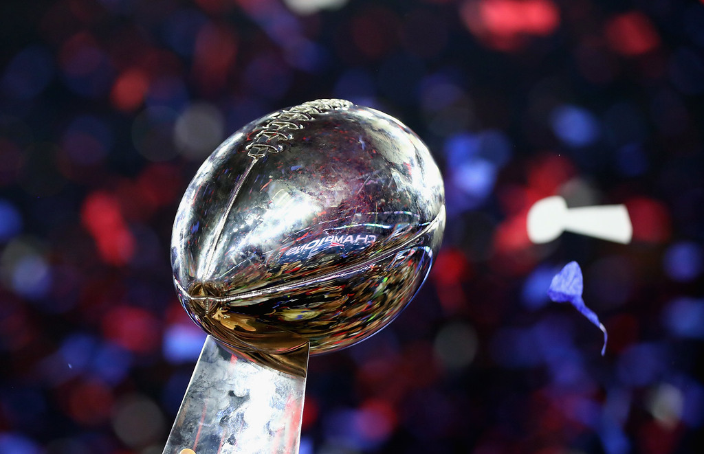 . HOUSTON, TX - FEBRUARY 05:  The New England Patriots celebrate with the Vince Lombardi Trophy after defeating the Atlanta Falcons during Super Bowl 51 at NRG Stadium on February 5, 2017 in Houston, Texas. The Patriots defeated the Falcons 34-28.  (Photo by Al Bello/Getty Images)