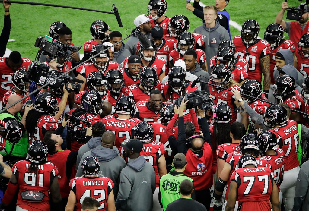 . Members of the Atlanta Falcons gather on the field before the NFL Super Bowl 51 football game against the New England Patriots, Sunday, Feb. 5, 2017, in Houston. (AP Photo/Charlie Riedel)