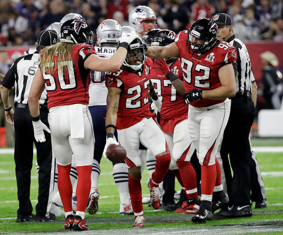 . Atlanta Falcons\' Robert Alford celebrates with his teammates after recovering a fumble during the first half of the NFL Super Bowl 51 football game against the New England Patriots Sunday, Feb. 5, 2017, in Houston. (AP Photo/David J. Phillip)