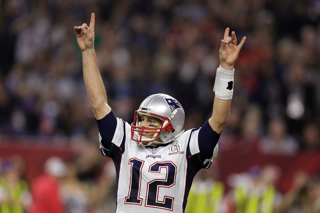 . New England Patriots\' Tom Brady raises his arms after scoring a touchdown during overtime of the NFL Super Bowl 51 football game against the Atlanta Falcons, Sunday, Feb. 5, 2017, in Houston. The Patriots defeated the Falcons 34-28. (AP Photo/Darron Cummings)