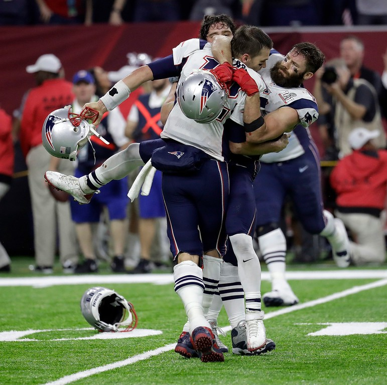 . New England Patriots\' Tom Brady, foreground, celebrates with his teammates after winning the NFL Super Bowl 51 football game against the Atlanta Falcons in overtime Sunday, Feb. 5, 2017, in Houston. The Patriots won 34-28. (AP Photo/Eric Gay)