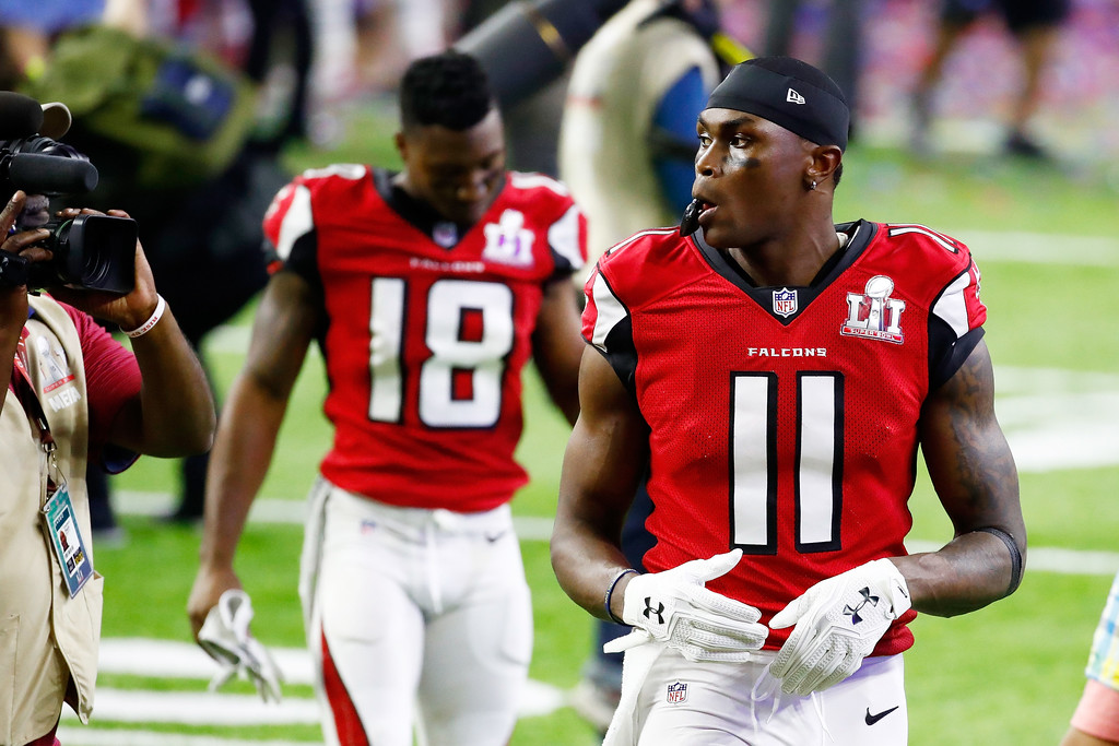. HOUSTON, TX - FEBRUARY 05:  Julio Jones #11 of the Atlanta Falcons walks off the field after losing to the New England Patriots 34-28 in overtime during Super Bowl 51 at NRG Stadium on February 5, 2017 in Houston, Texas.  (Photo by Gregory Shamus/Getty Images)