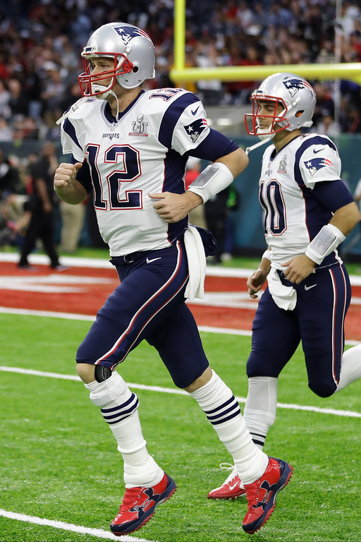 . New England Patriots\' Tom Brady and Jimmy Garoppolo run on the field before the NFL Super Bowl 51 football game against the Atlanta Falcons, Sunday, Feb. 5, 2017, in Houston. (AP Photo/Patrick Semansky)