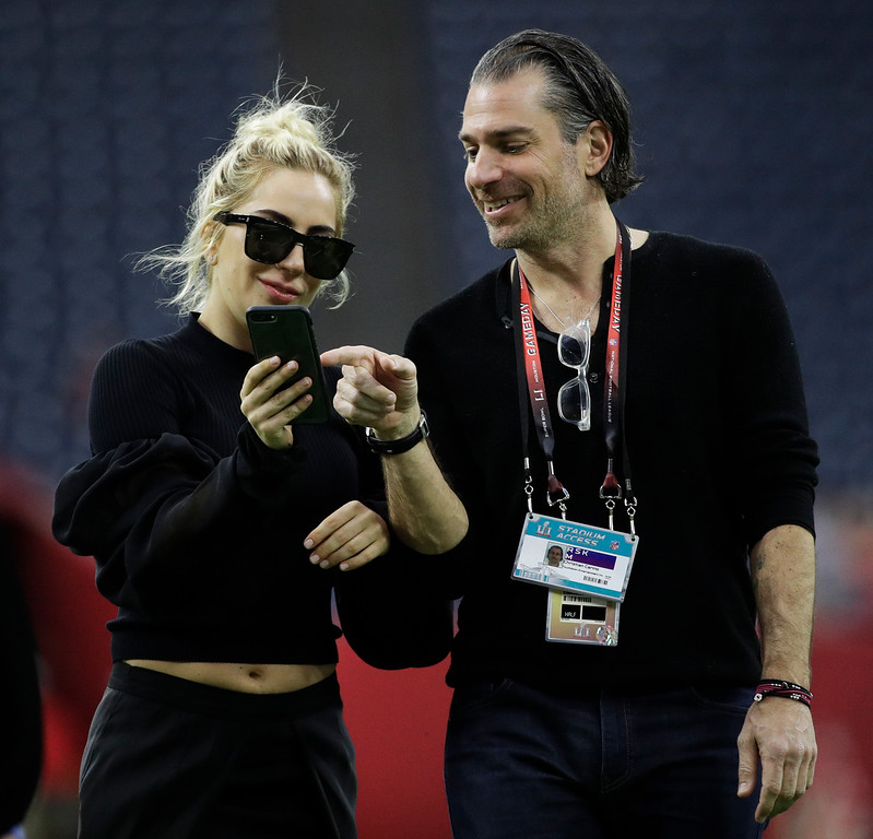 . Lady Gaga talks with Christian Carino on the field before the NFL Super Bowl 51 football game between the New England Patriots and the Atlanta Falcons, Sunday, Feb. 5, 2017, in Houston. (AP Photo/Jae C. Hong)