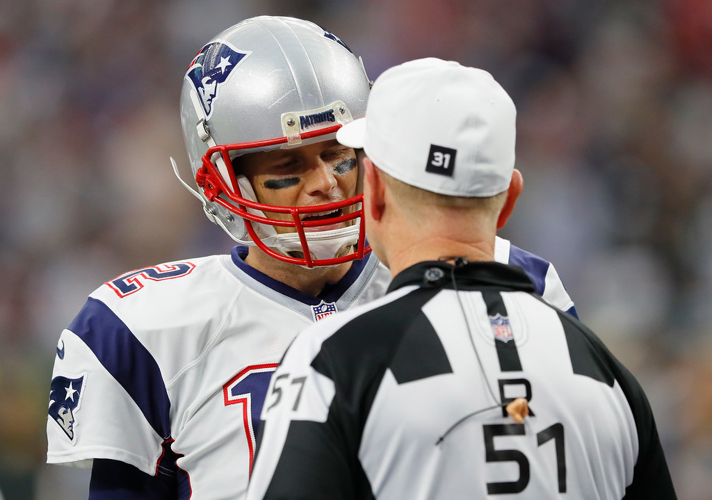 . HOUSTON, TX - FEBRUARY 05: Tom Brady #12 of the New England Patriots speaks to referee Carl Cheffers #51 prior to Super Bowl 51 against the Atlanta Falcons at NRG Stadium on February 5, 2017 in Houston, Texas.  (Photo by Kevin C. Cox/Getty Images)