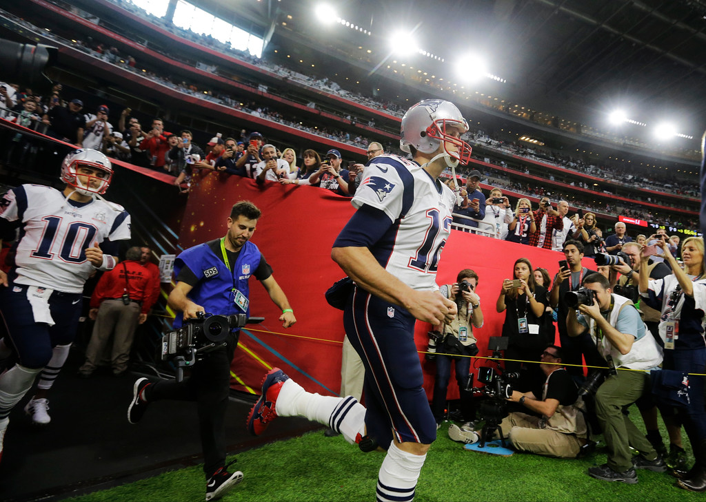 . New England Patriots\' Tom Brady runs on to field before the NFL Super Bowl 51 football game against the Atlanta Falcons, Sunday, Feb. 5, 2017, in Houston. (AP Photo/Elise Amendola)