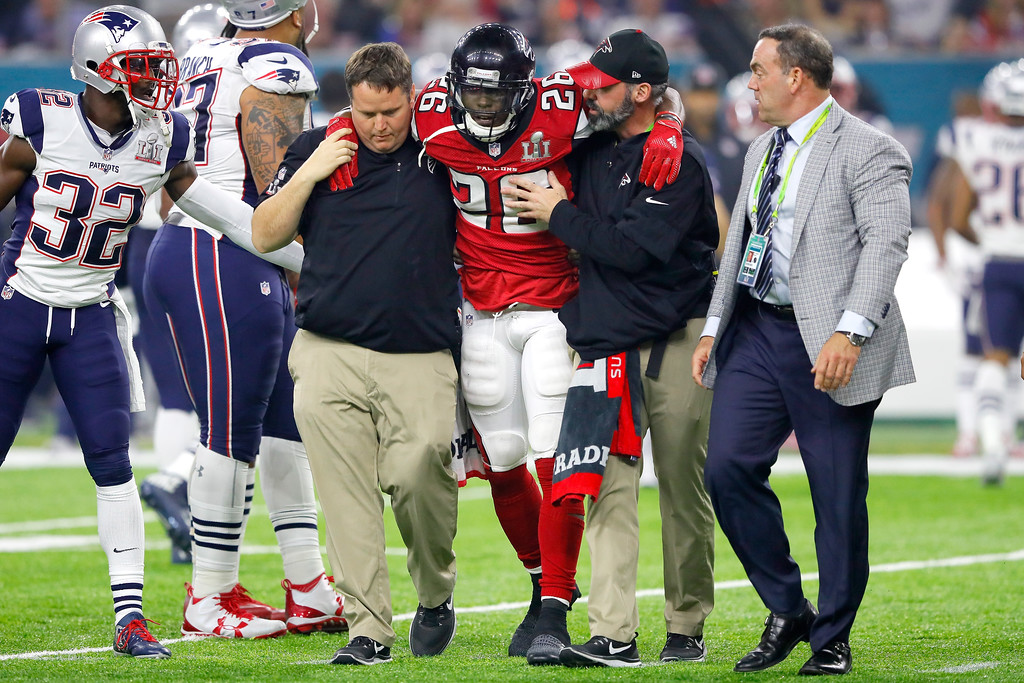 . HOUSTON, TX - FEBRUARY 05: Tevin Coleman #26 of the Atlanta Falcons is helped off the field after an injury during the fourth quarter against the New England Patriots  during Super Bowl 51 at NRG Stadium on February 5, 2017 in Houston, Texas.  (Photo by Kevin C. Cox/Getty Images)