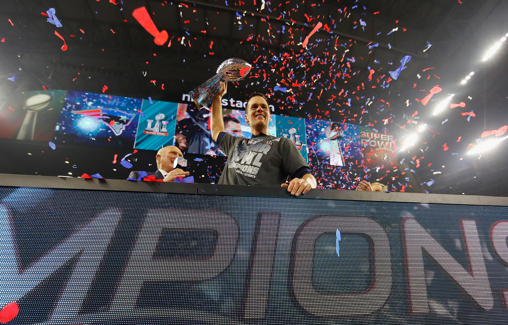 . HOUSTON, TX - FEBRUARY 05:  Tom Brady #12 of the New England Patriots raises the Vince Lombardi Trophy after defeating the Atlanta Falcons during Super Bowl 51 at NRG Stadium on February 5, 2017 in Houston, Texas. The Patriots defeated the Falcons 34-28.  (Photo by Kevin C. Cox/Getty Images)