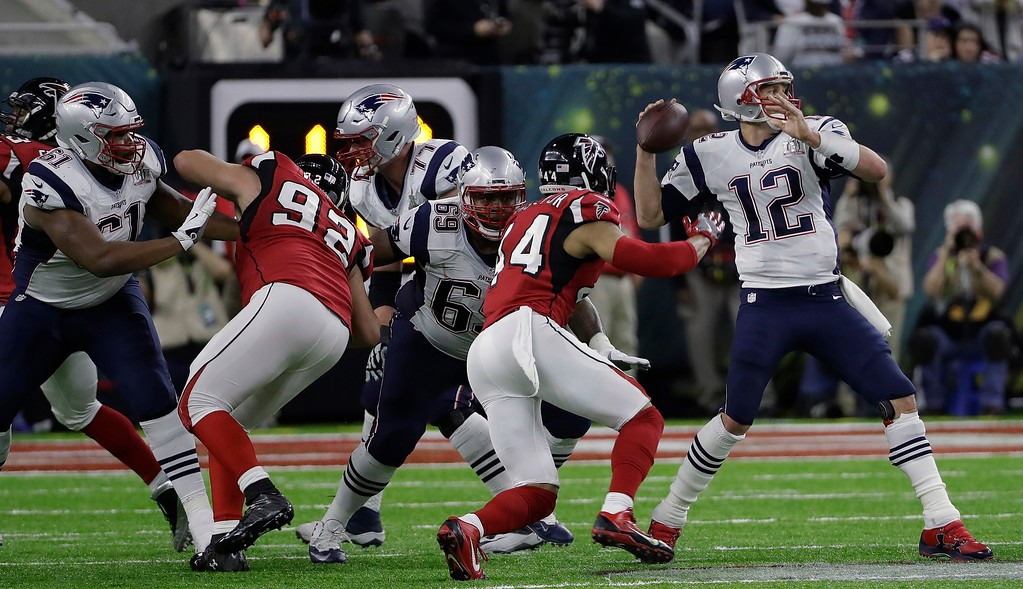 . New England Patriots\' Tom Brady throws a pass under pressure during the first half of the NFL Super Bowl 51 football game against the Atlanta Falcons Sunday, Feb. 5, 2017, in Houston. (AP Photo/David J. Phillip)