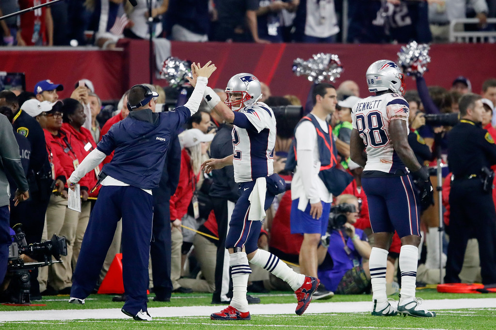 . HOUSTON, TX - FEBRUARY 05:  Tom Brady #12 of the New England Patriots celebrates after a score against the Atlanta Falcons in the fourth quarter during Super Bowl 51 at NRG Stadium on February 5, 2017 in Houston, Texas.  (Photo by Gregory Shamus/Getty Images)