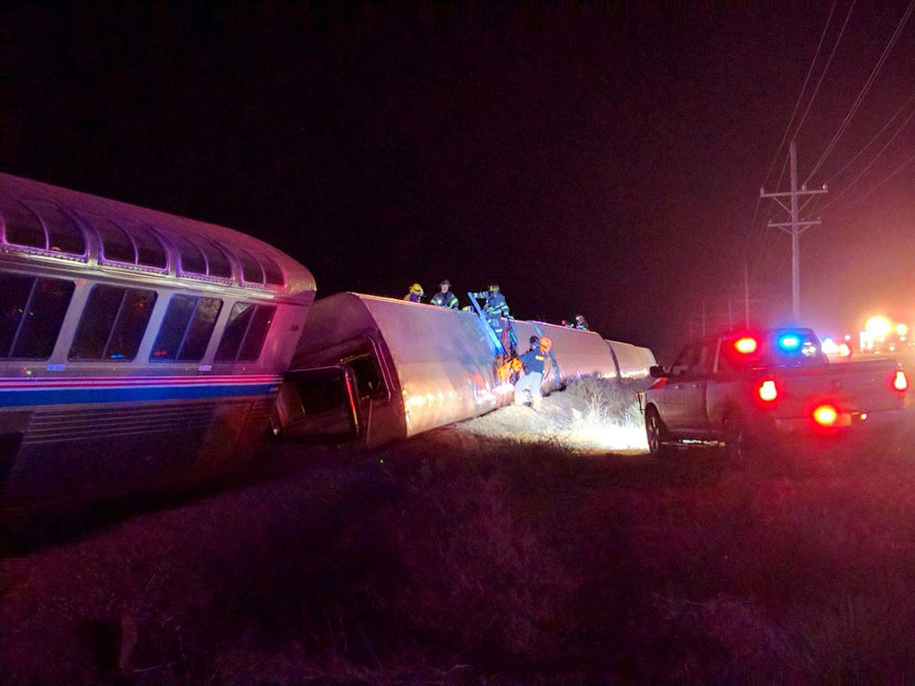 . Emergency personnel work on a train that derailed near Dodge City, Kan., Monday, March 14, 2016. An Amtrak statement says the train was traveling from Los Angeles to Chicago early Monday when it derailed just after midnight. (Daniel Szczerba via AP)