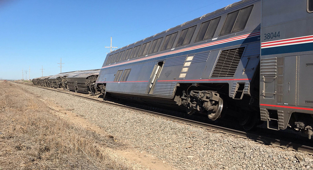 . An Amtrak train derailed in southwest Kansas early Monday, March 14, 2016, injuring multiple people who were transferred to hospitals in Garden City and Dodge City, according to a release from Amtrak. The Amtrak train carrying 131 passengers derailed in rural Kansas moments after an engineer noticed a significant bend in a rail and applied the emergency brakes, an official said.   (Oliver Morrison /The Wichita Eagle via AP)